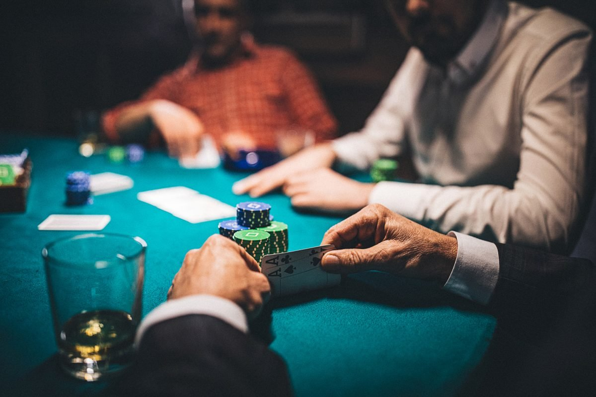 men at poker table