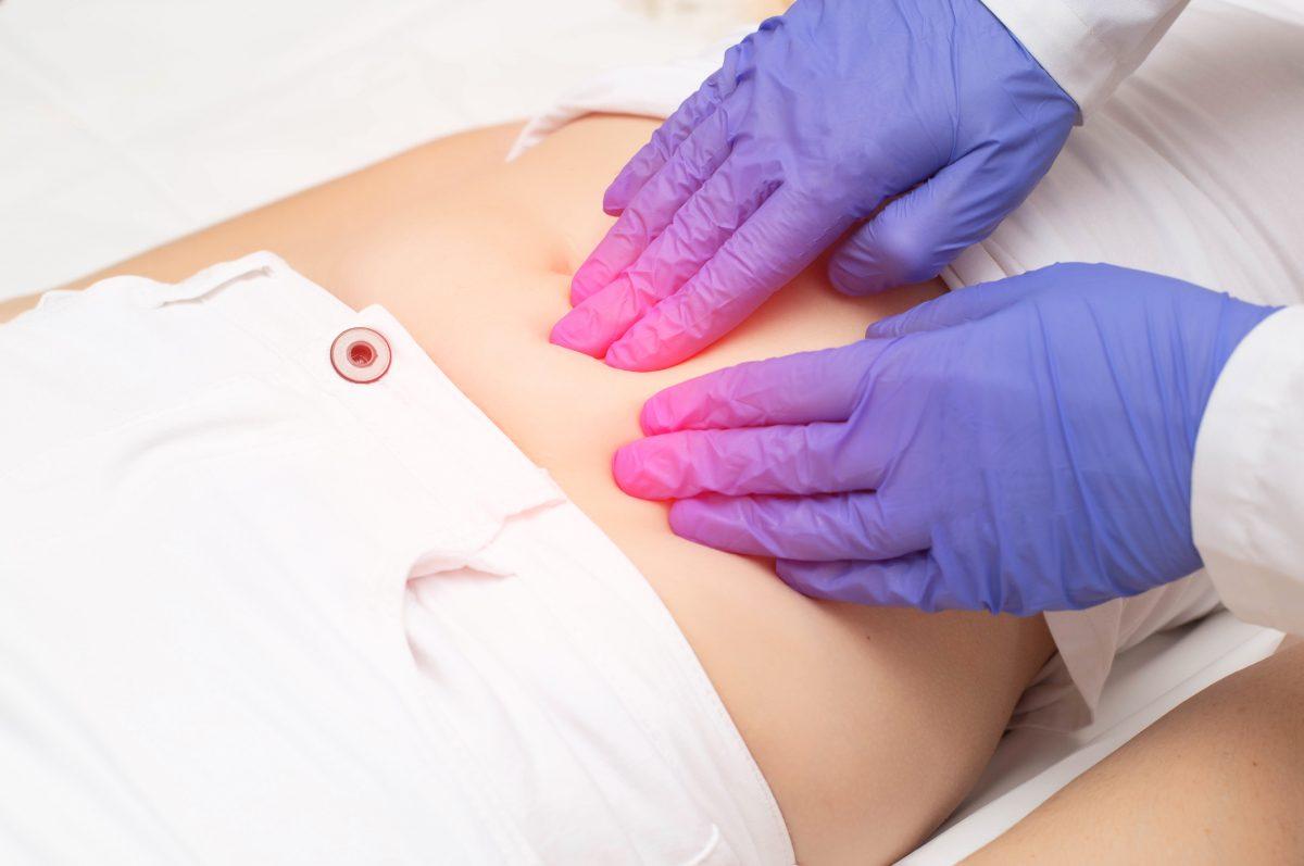 Doctor checks woman for fibroids