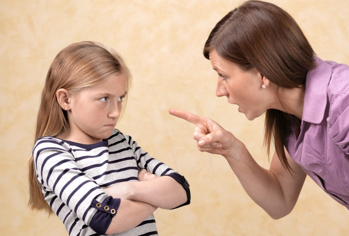 Mother scolding child