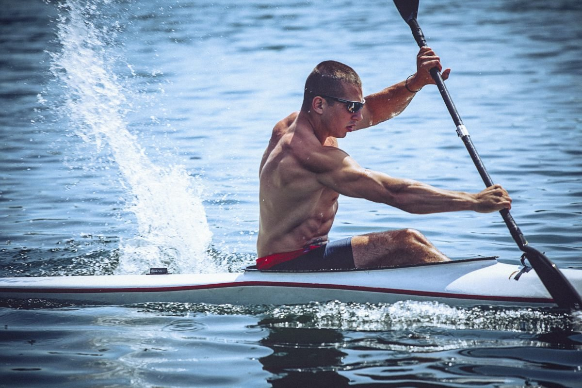 muscular man kayaking