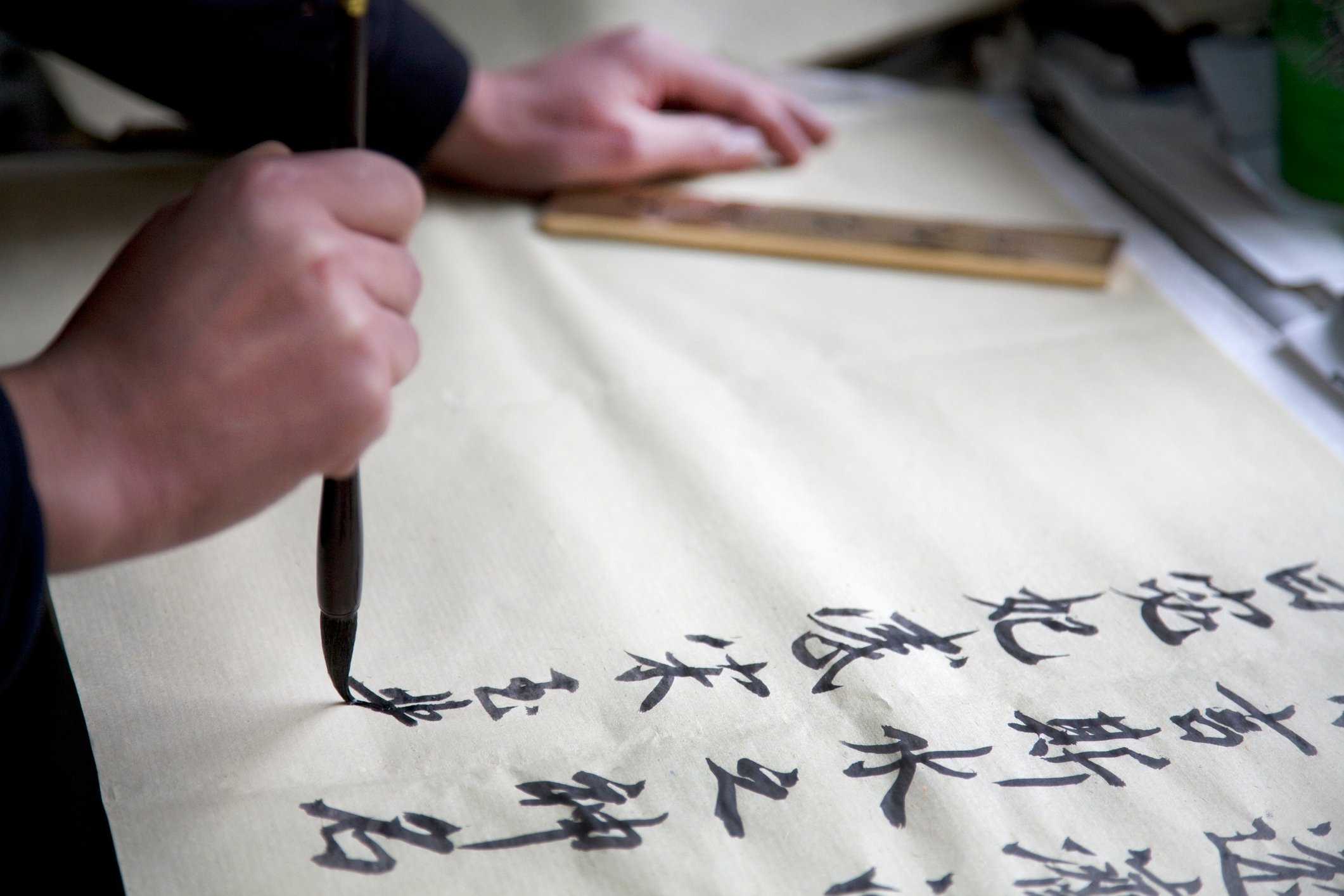 poetry writing using chinese calligraphy and characters.