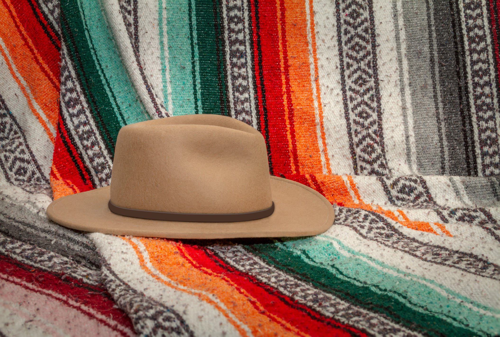 Mexican blanket with a brown hat
