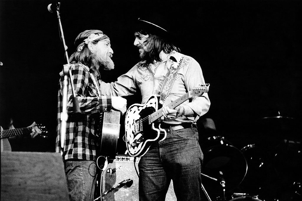 Willie Nelson and Waylon Jennings perform on stage together, New York, April 1978.