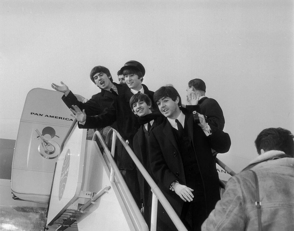 2nd February 1964: The Beatles, left to right: George Harrison (1943 - 2001), John Lennon (1940 - 1980) Ringo Starr and Paul McCartney at London Airport on their way to appear in New York.