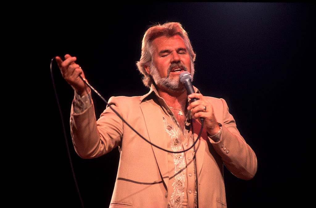 American musician Kenny Rogers performs at the Rosemont Horizon (later renamed the Allstate Arena), Rosemont, Illinois, July 10, 1981.
