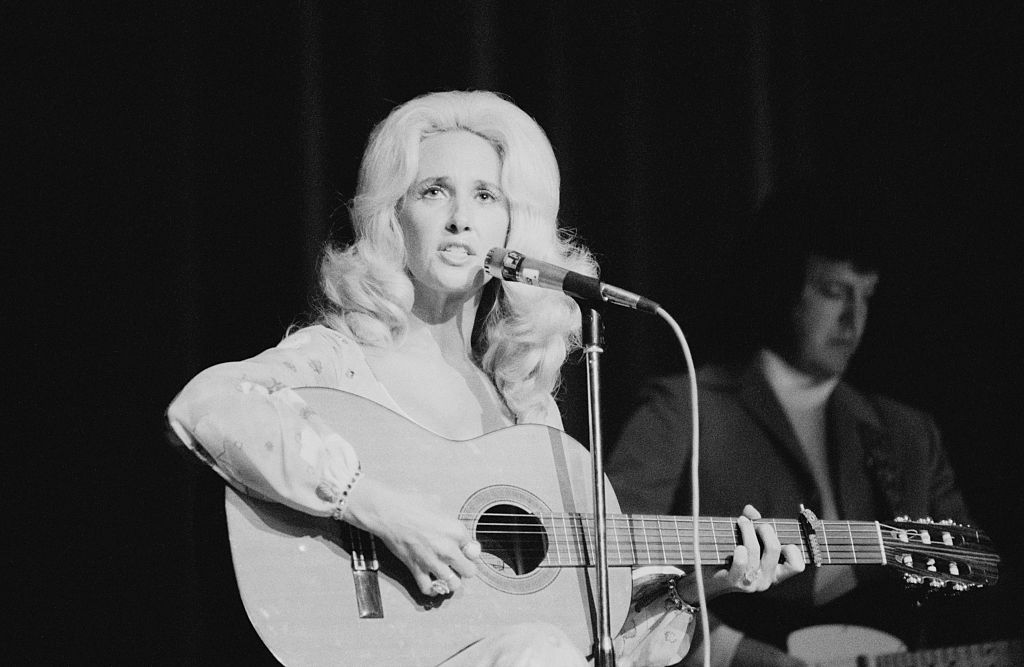 American country music singer-songwriter Tammy Wynette (1942 - 1998) performing at the Hammersmith Odeon, London, June 1975.