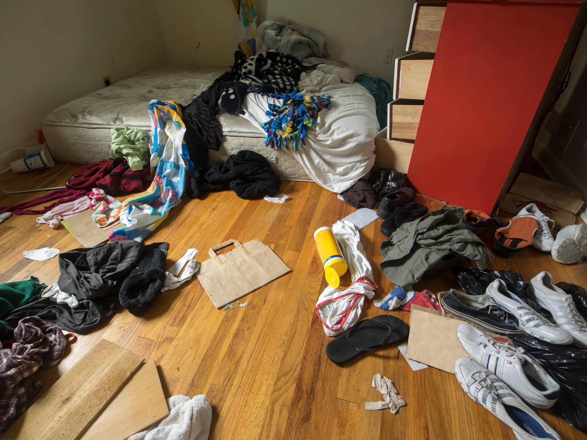 Messy room with shoes and clothes inside a foreclosed house in Portland, Oregon.