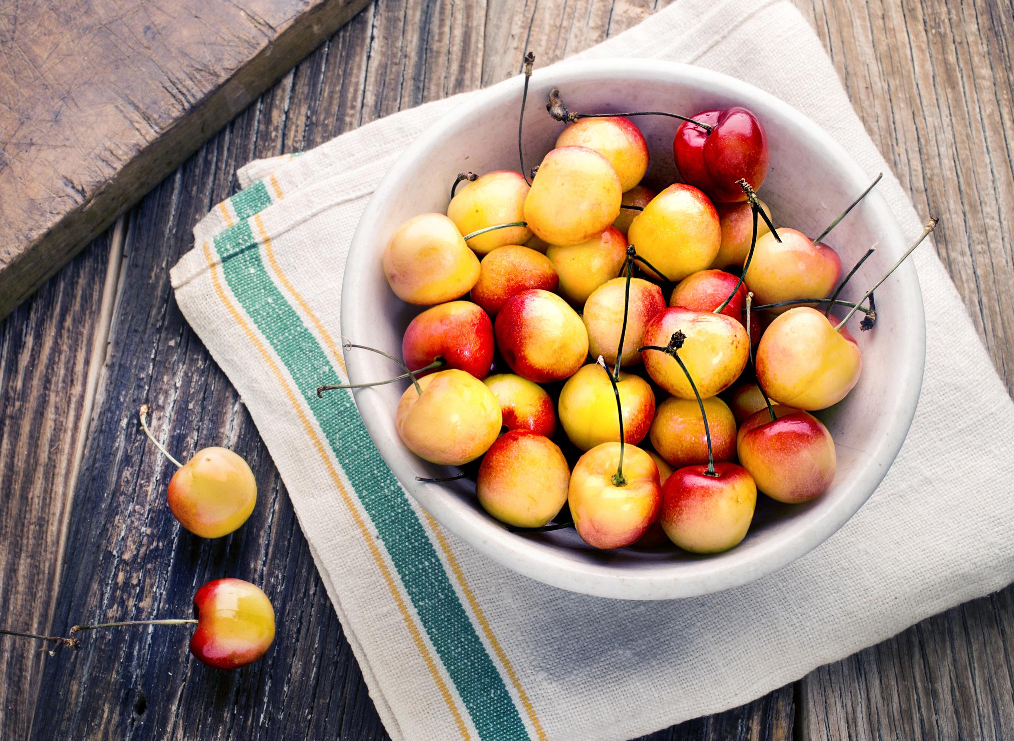 Bowl of yellow cherries