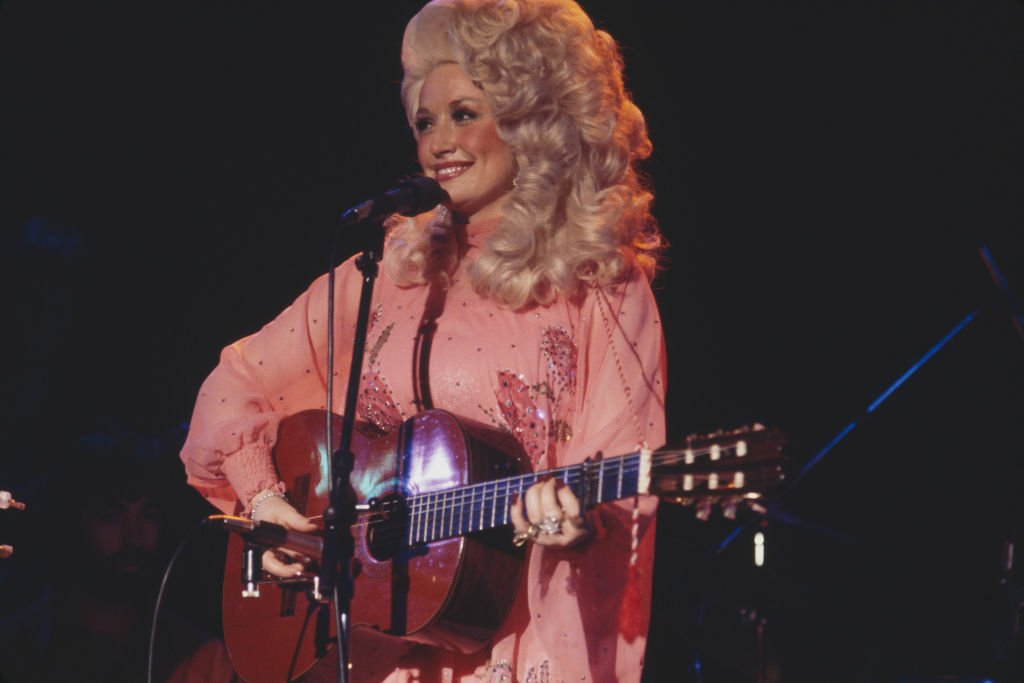 American country and western singer Dolly Parton performs live on stage at the Bottom Line club in New York on 11th May 1977.