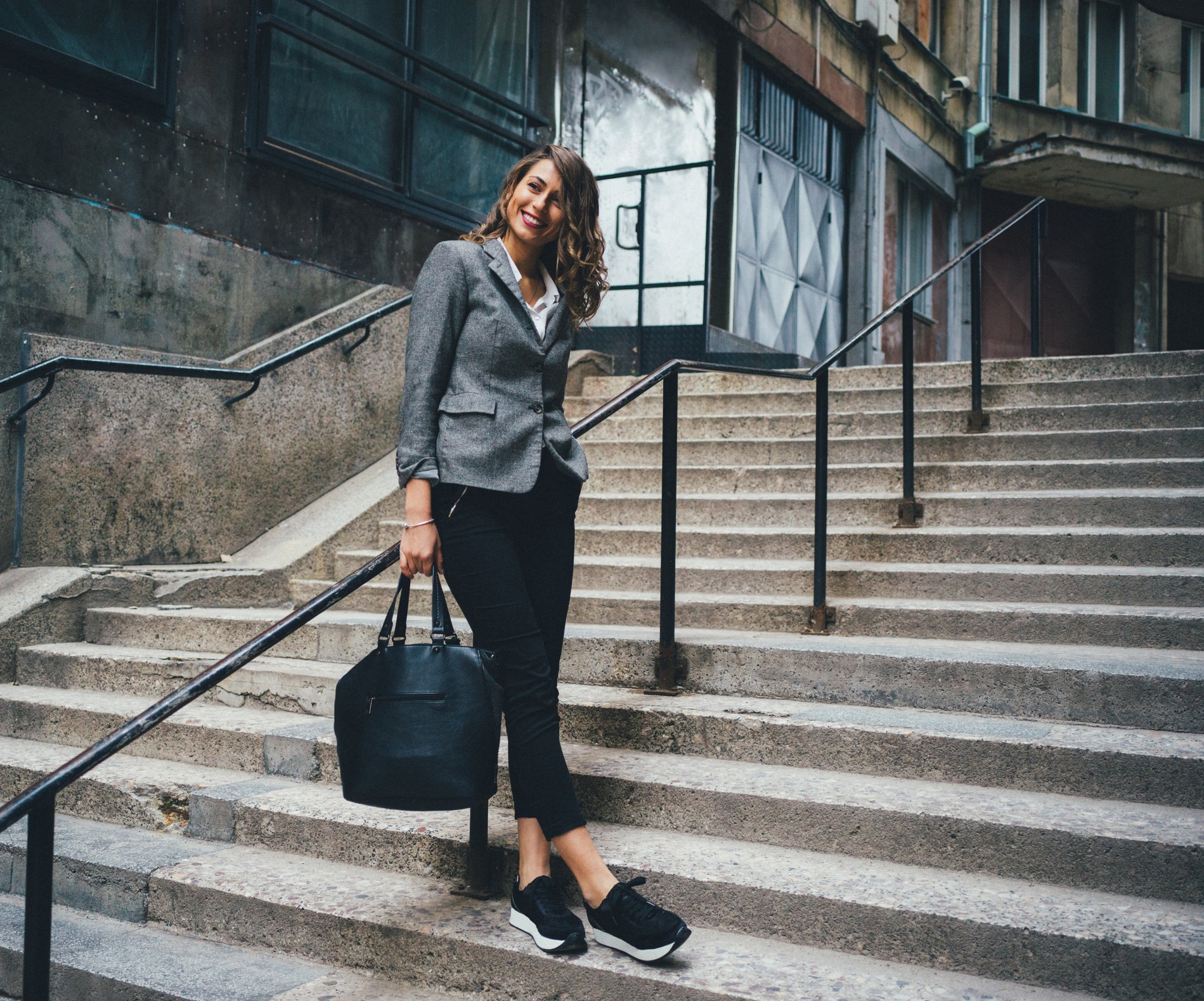 Woman standing on the stairs in the city.