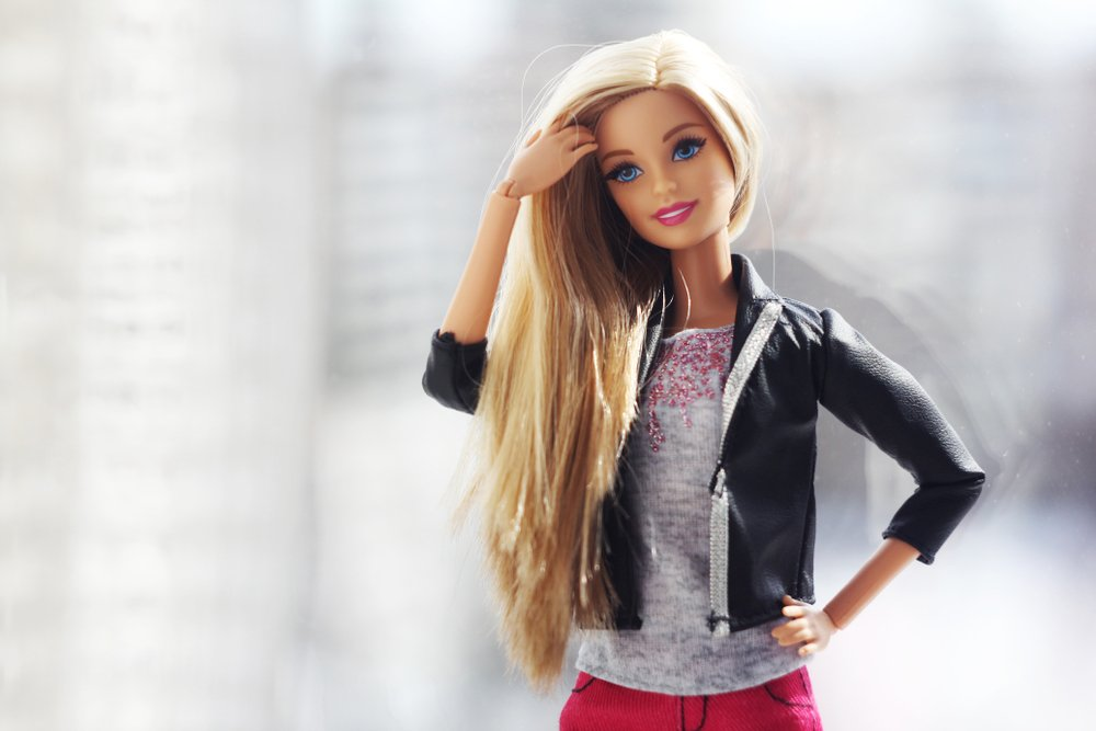 A beautiful barbie with white hair. Stylish doll.