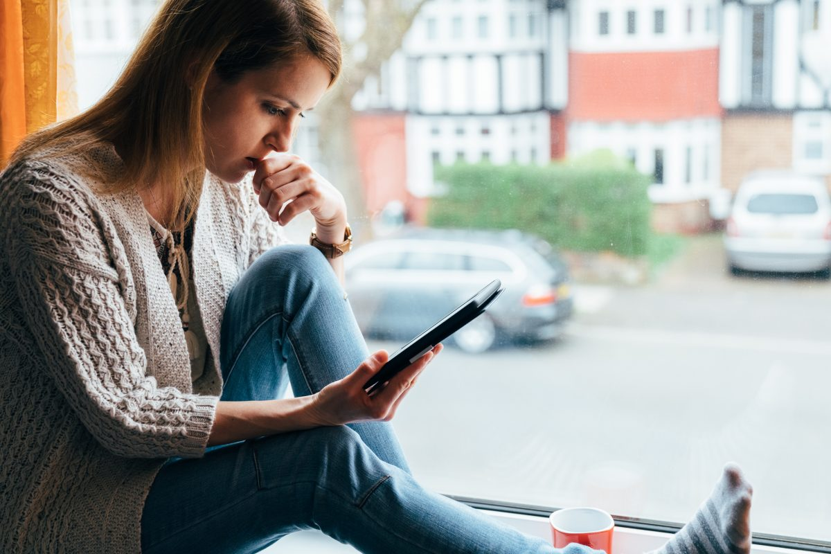 Woman reading on phone