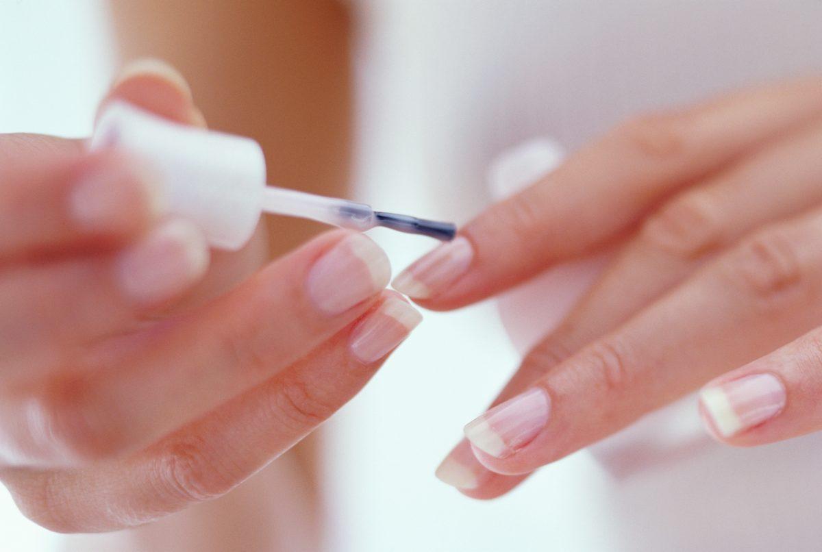applying nail treatment