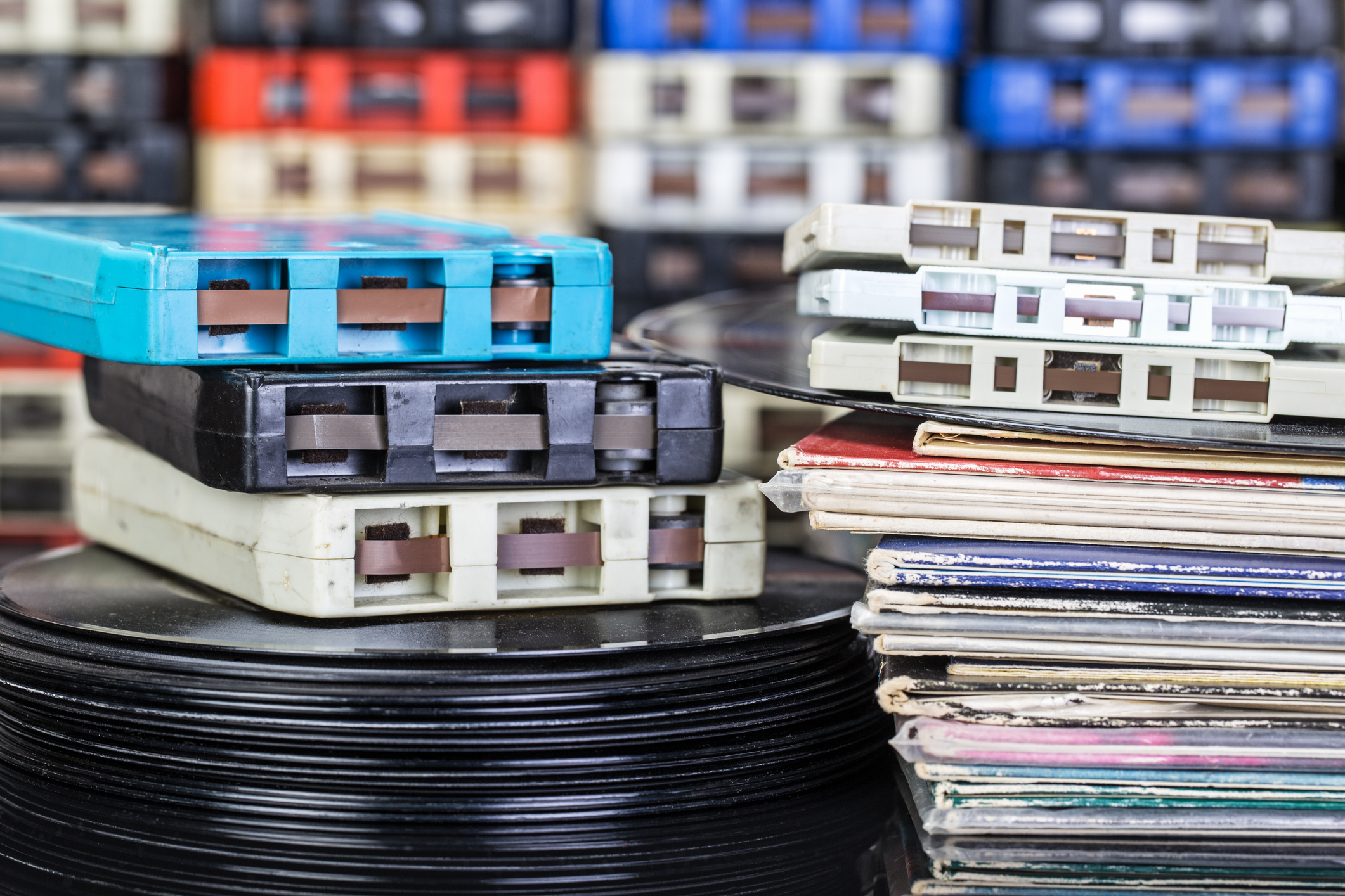 A collection of 33 rpm record albums, 45 rpm records, 8-track and cassette tapes.