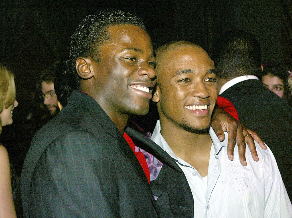 """LOS ANGELES - OCTOBER 6: Cast members Derek Luke (L) and Lee Thompson Young pose at the after party for the premiere of Universal's """"Friday Night Lights"""" at the Highlands on October 6, 2004 in Los Angeles, California. (Photo by Kevin Winter/Getty Images)"""