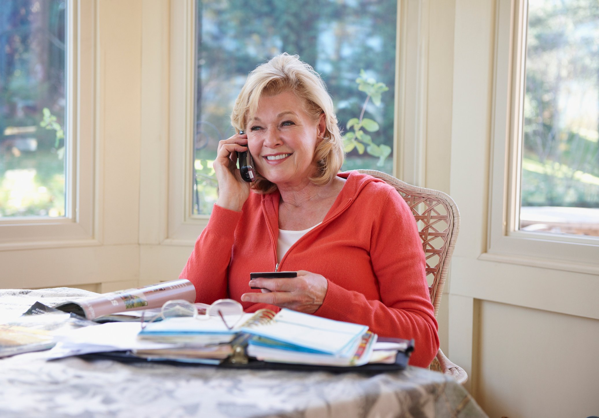 Woman shopping from catalog by telephone