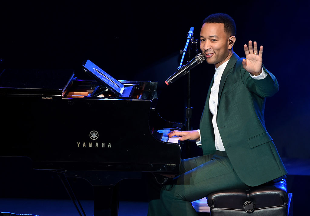 "John Legend performs onstage during the ""Hillary Clinton: She's With Us"" concert at The Greek Theatre on June 6, 2016 in Los Angeles, California. (Photo by Kevin Winter/Getty Images)"