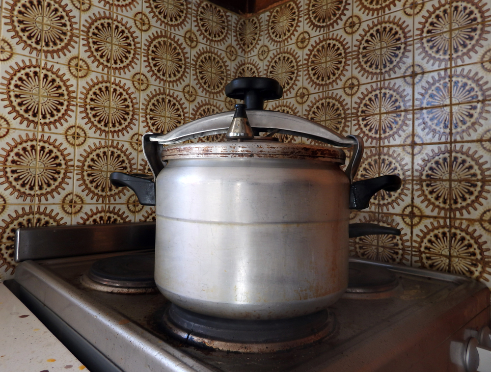old dirty pressure cooker in a retro kitchen