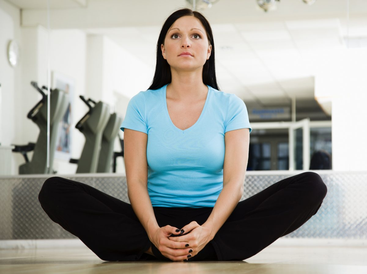 Woman performing inner thigh stretch