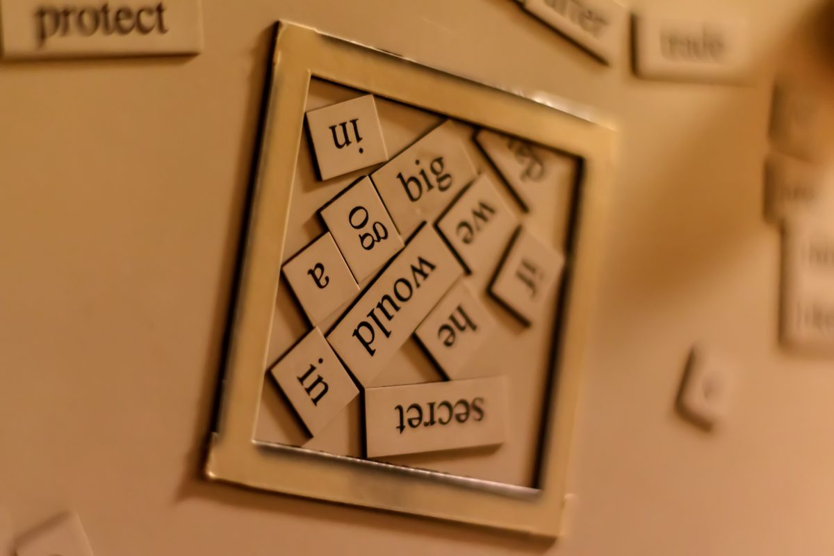 Wordplay tiles on fridge