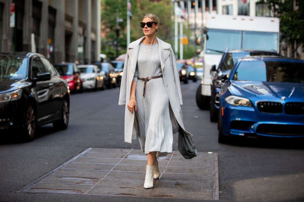 Sofie Valkiers is seen wearing total look Marc Cain: light blue pleated dress and wool coat, belt, bag, ankle boots during New York Fashion Week September