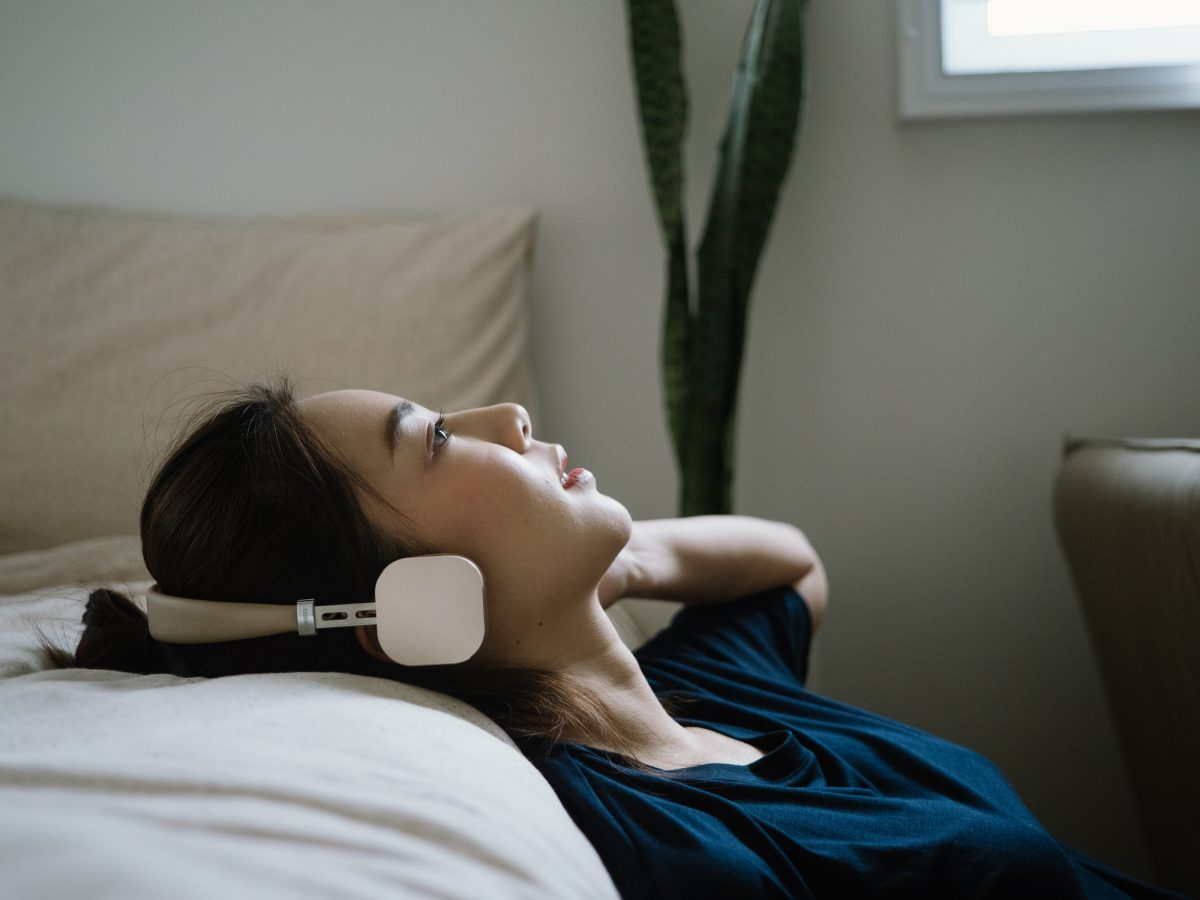 woman headphones relaxing treatment