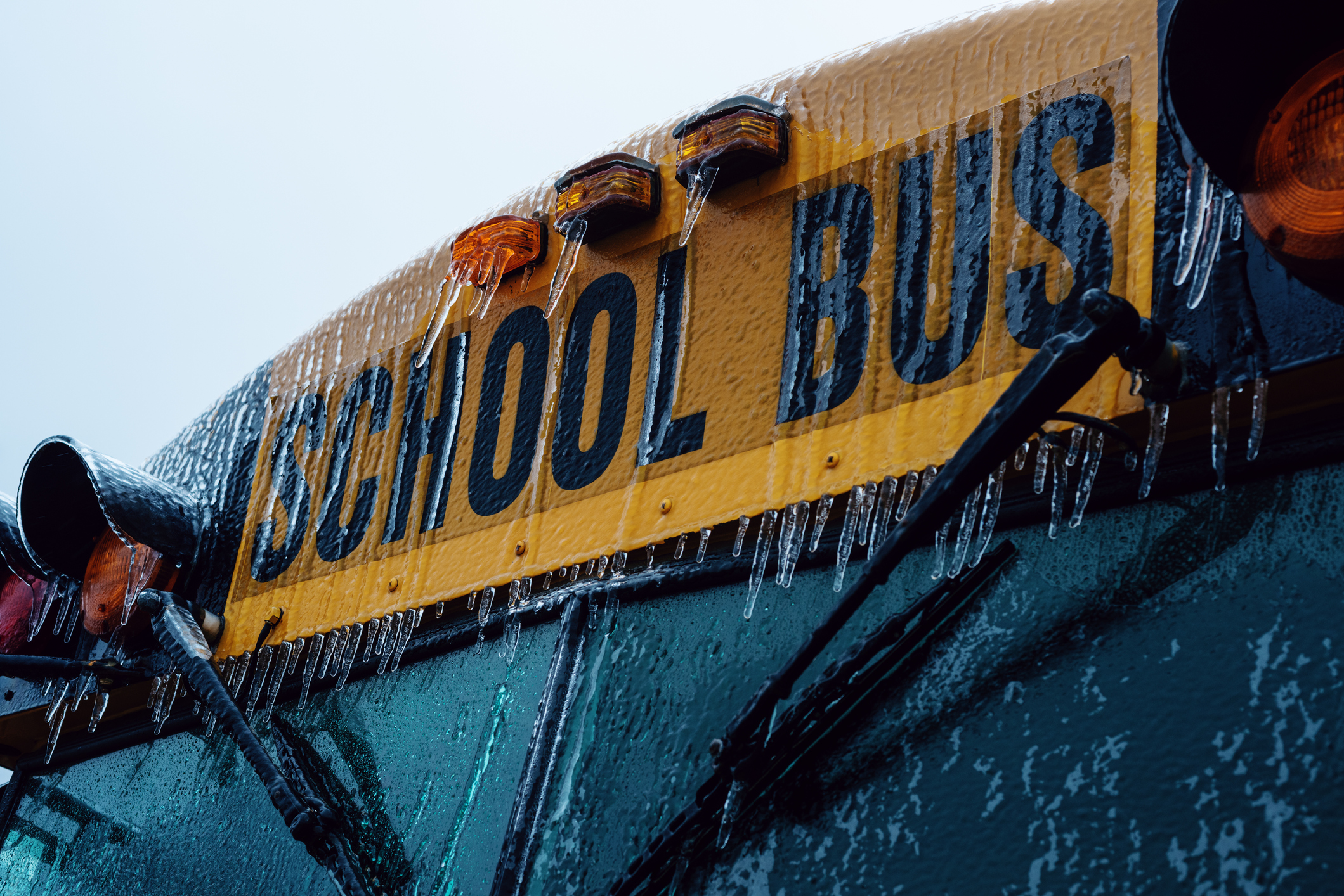 A school bus in covered in a thick layer of ice.