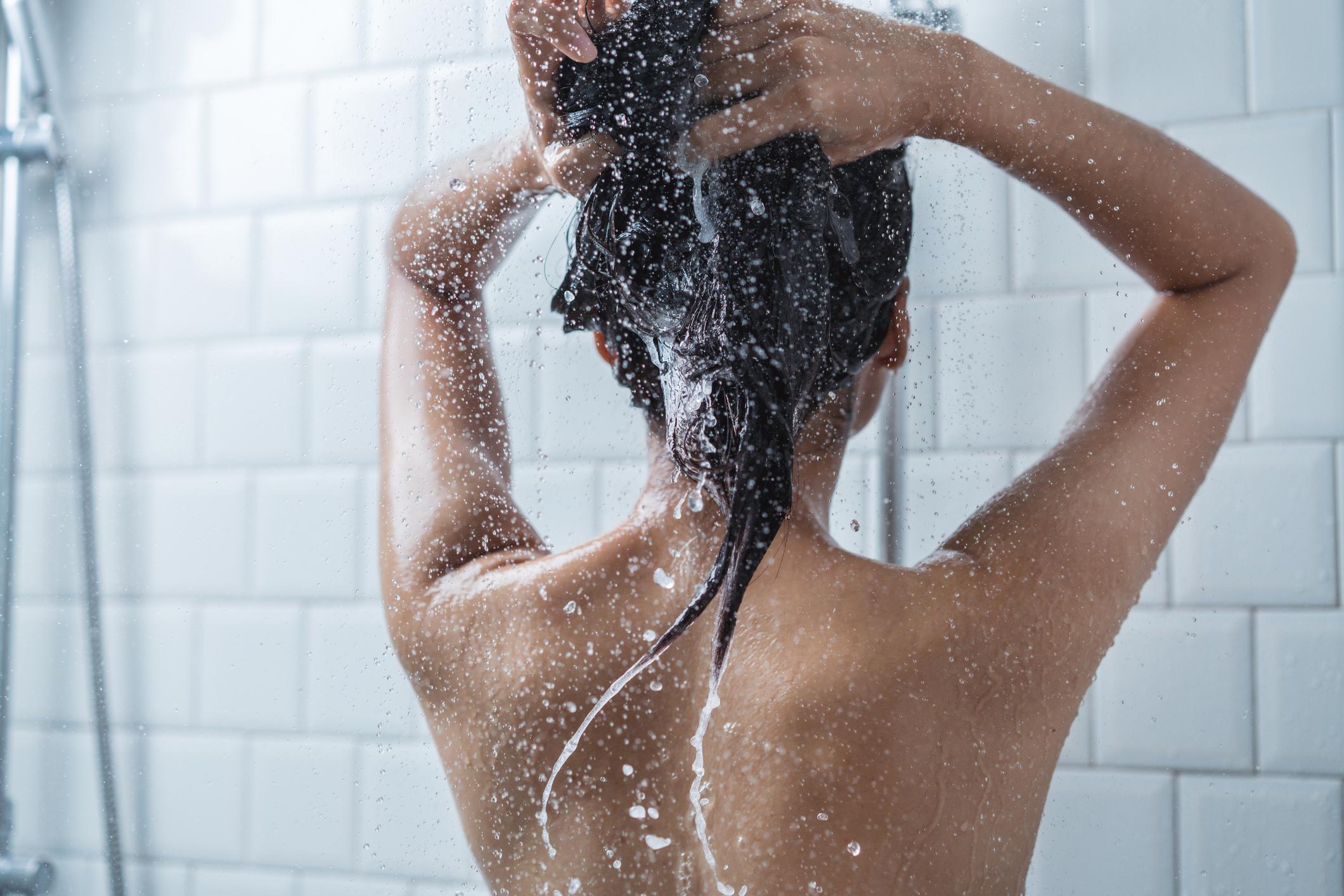 Asian women bathing and she was bathing and washing hair.