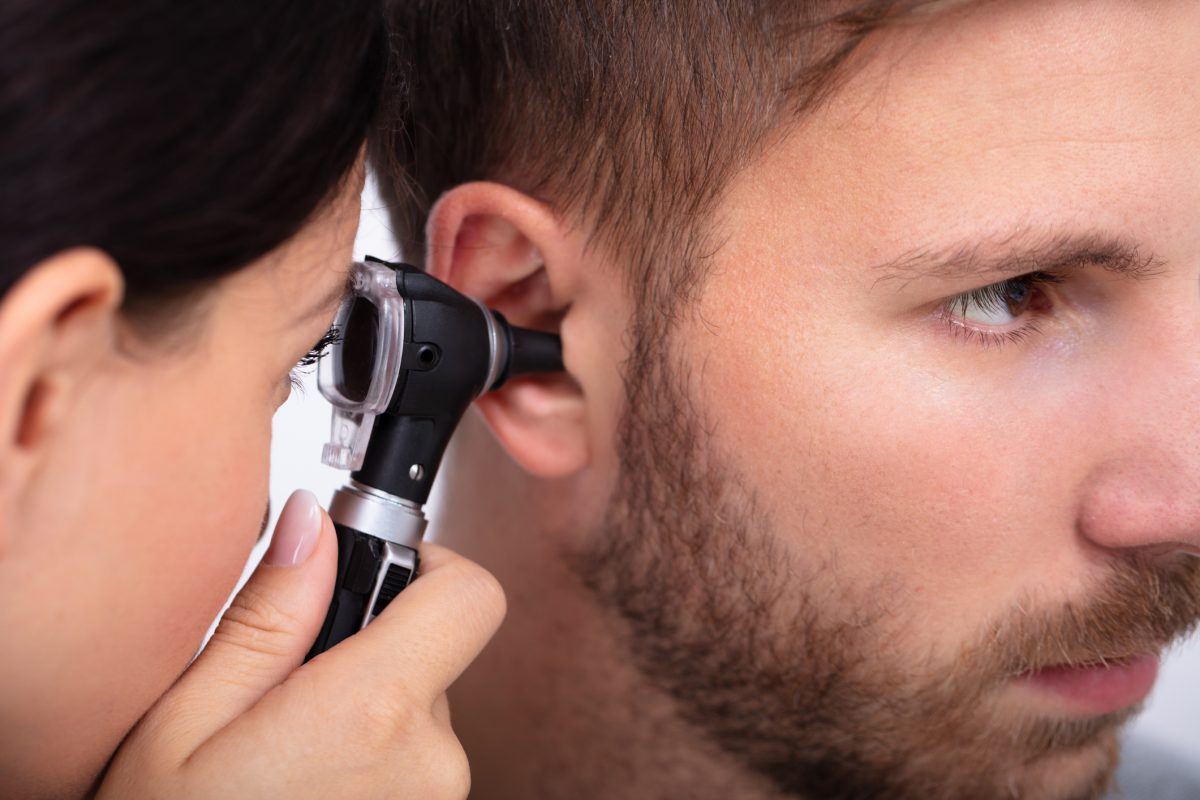 doctor male ear exam