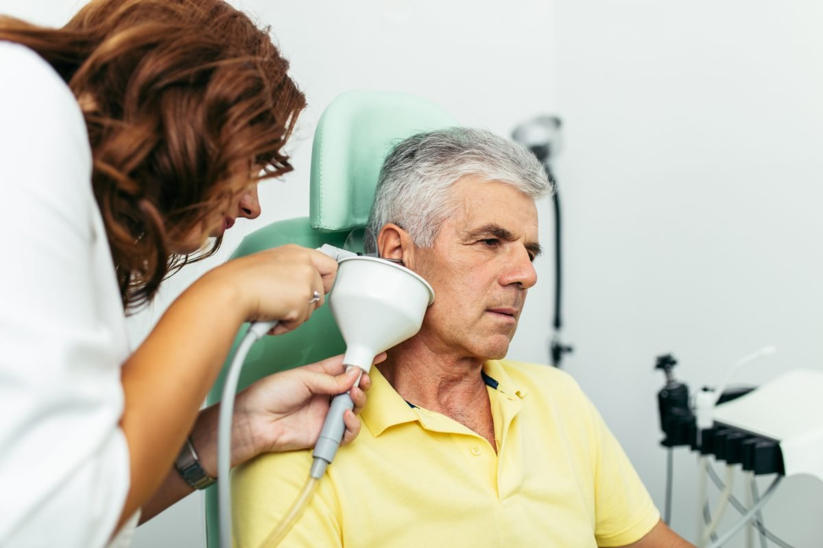 doctor ear cleaning patient