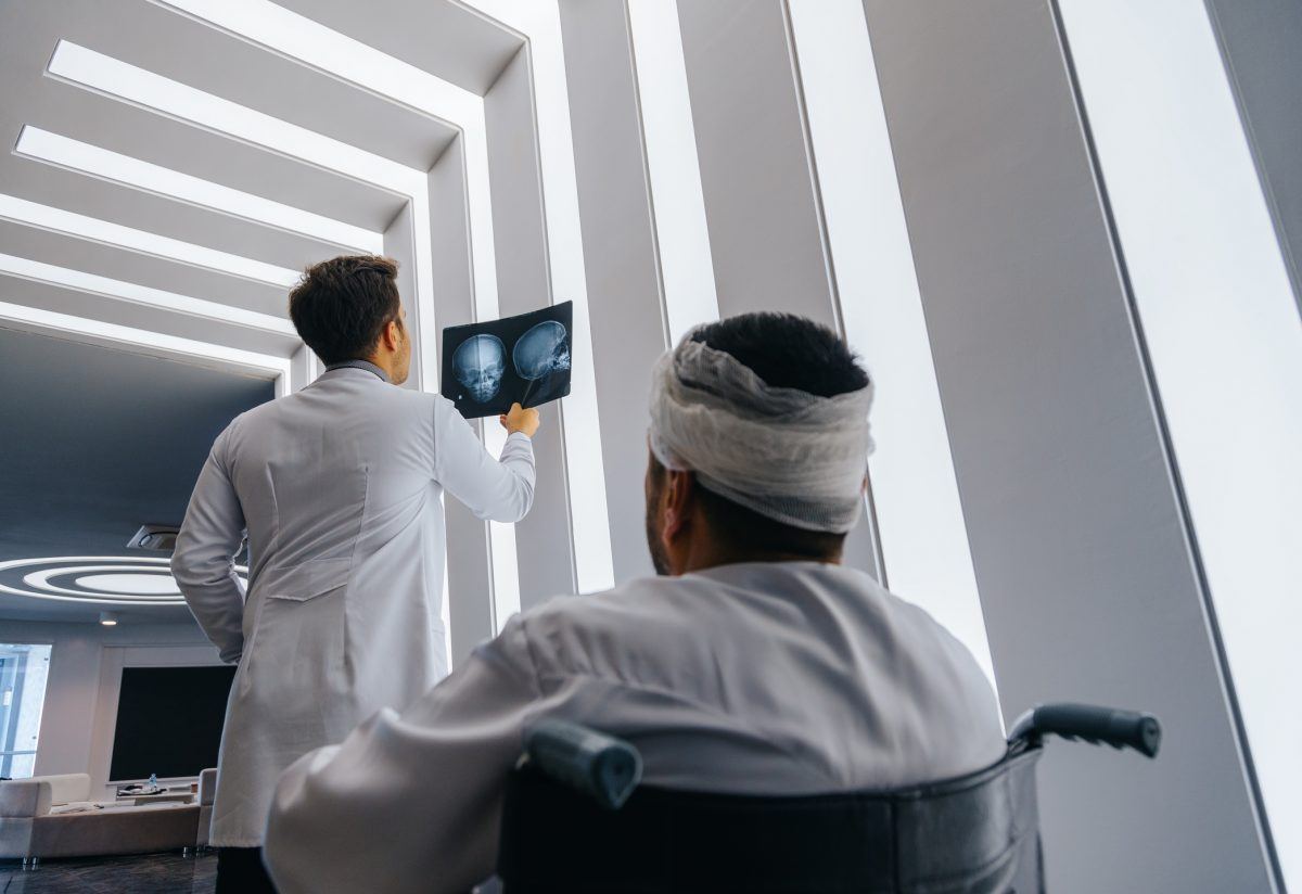 doctor man imaging head trauma