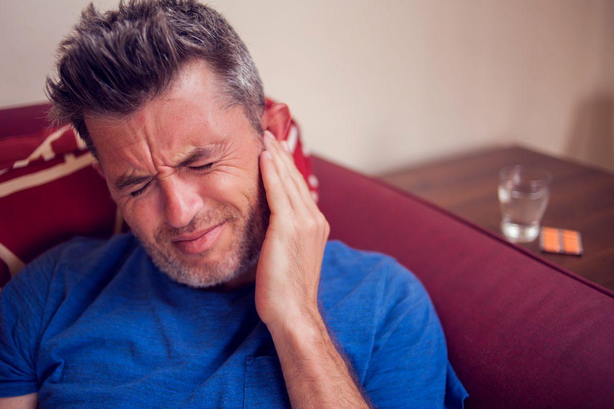 man ear pain eardrum
