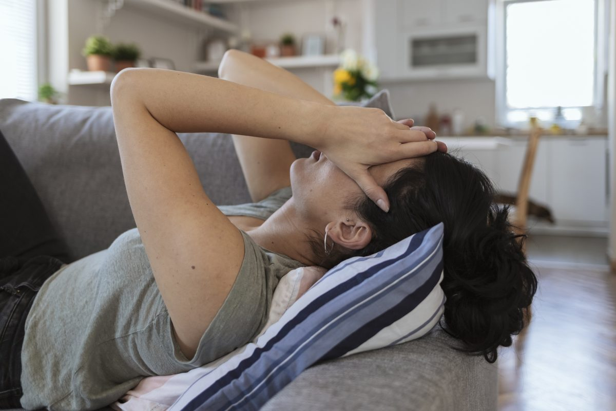 woman lying couch anxiety