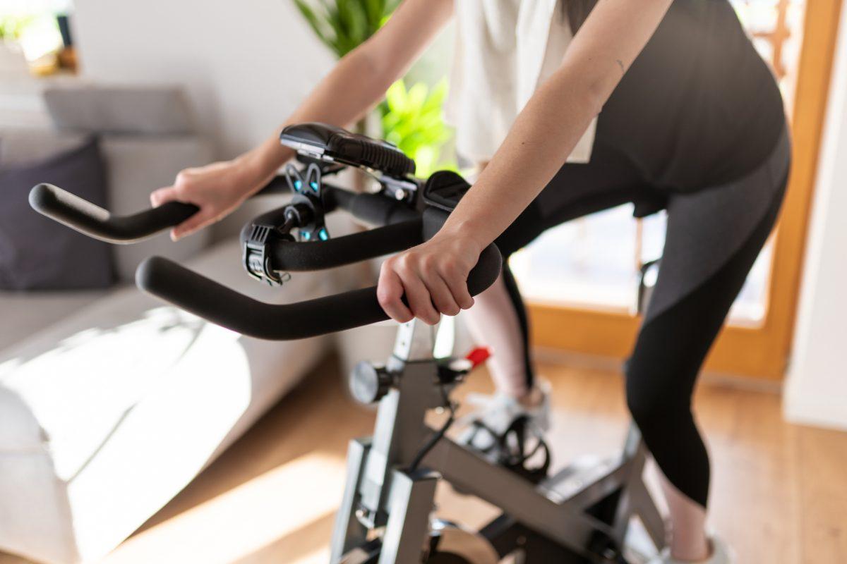 woman exercising home cycling