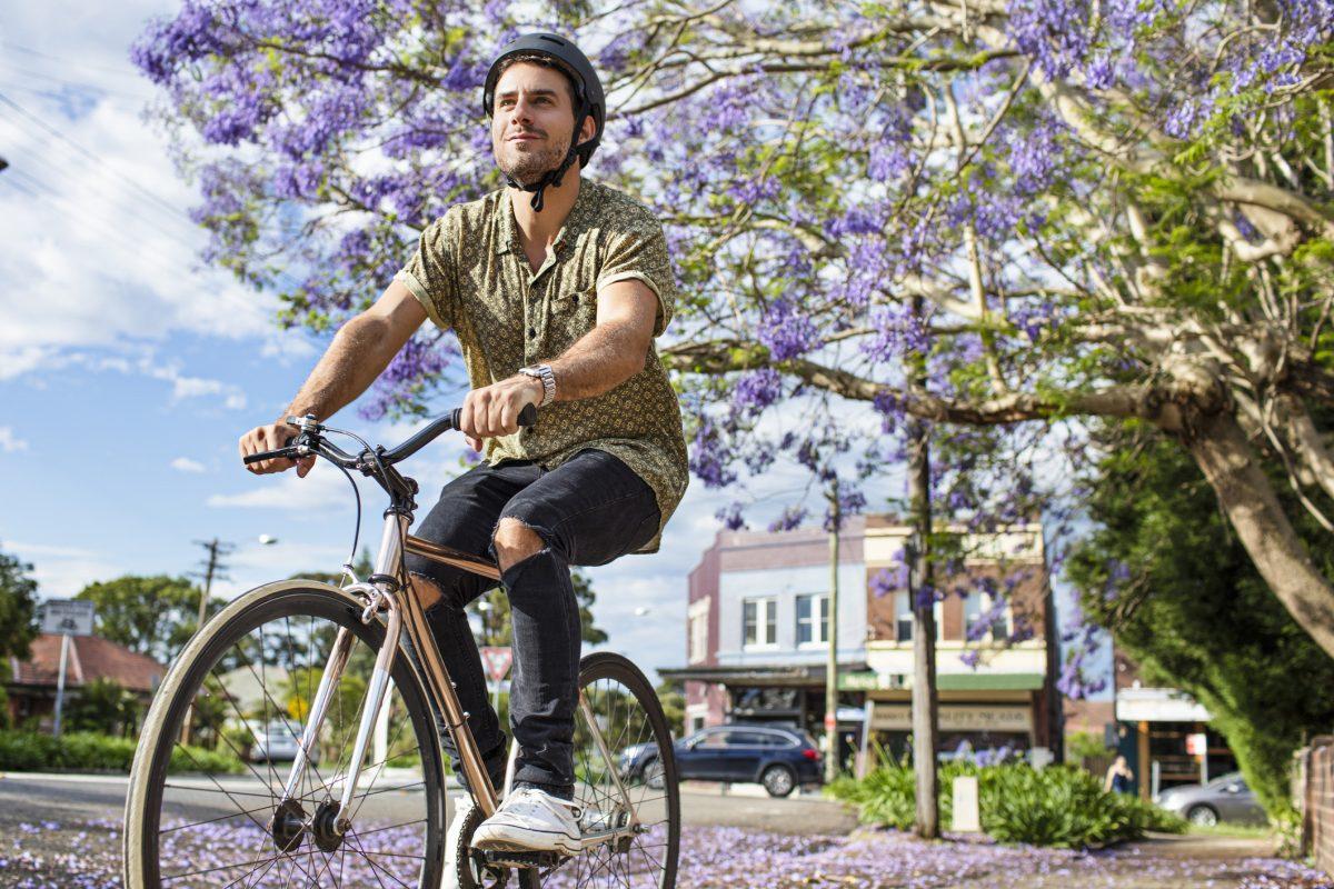 man riding bicycle tree