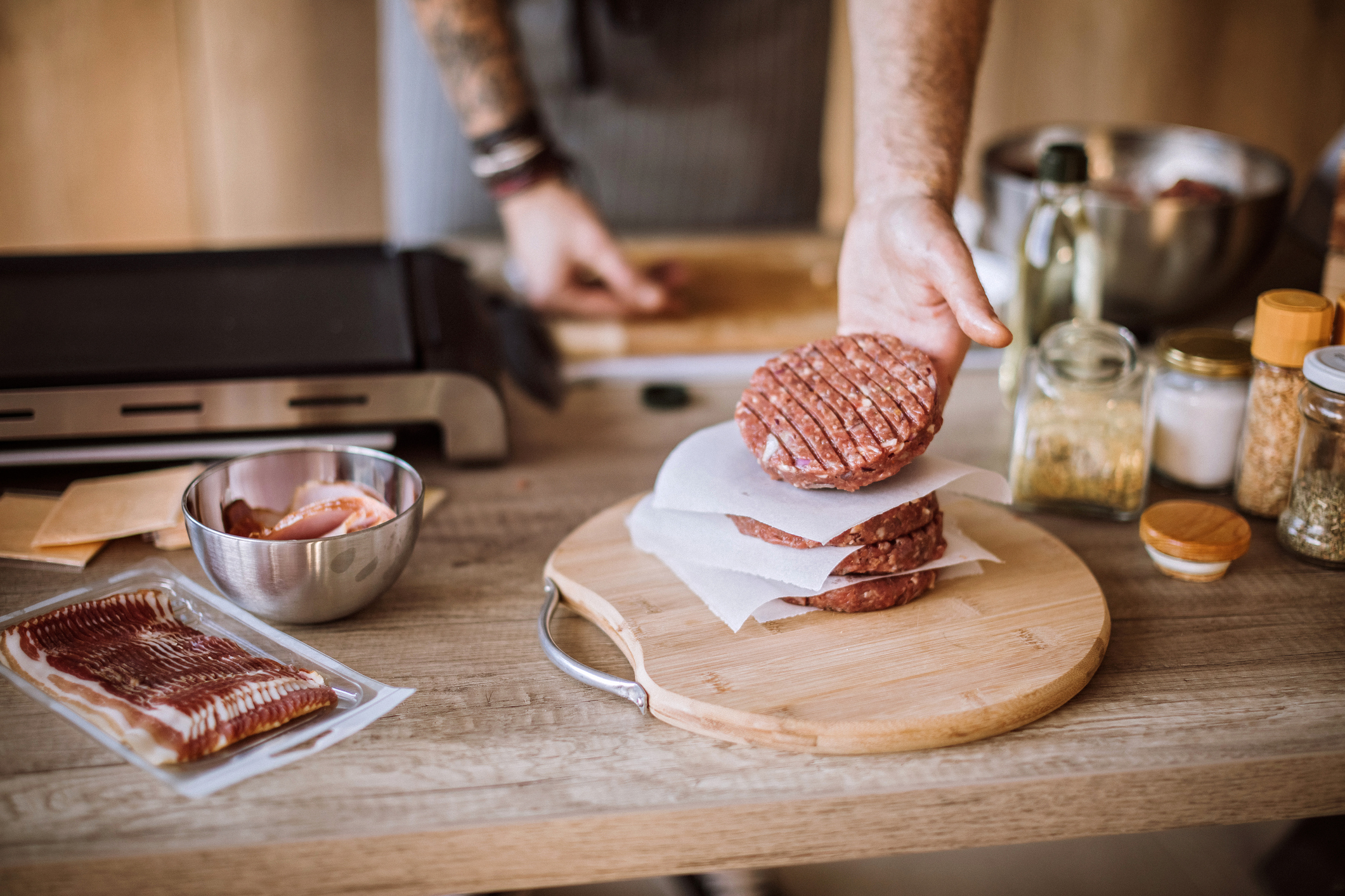 Young Chef Making Burgers Out Of Beef, Forming Shapes Carefully at Domestic Kitchen