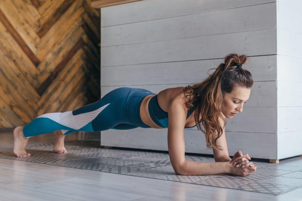 woman in plank pose feet hip width apart