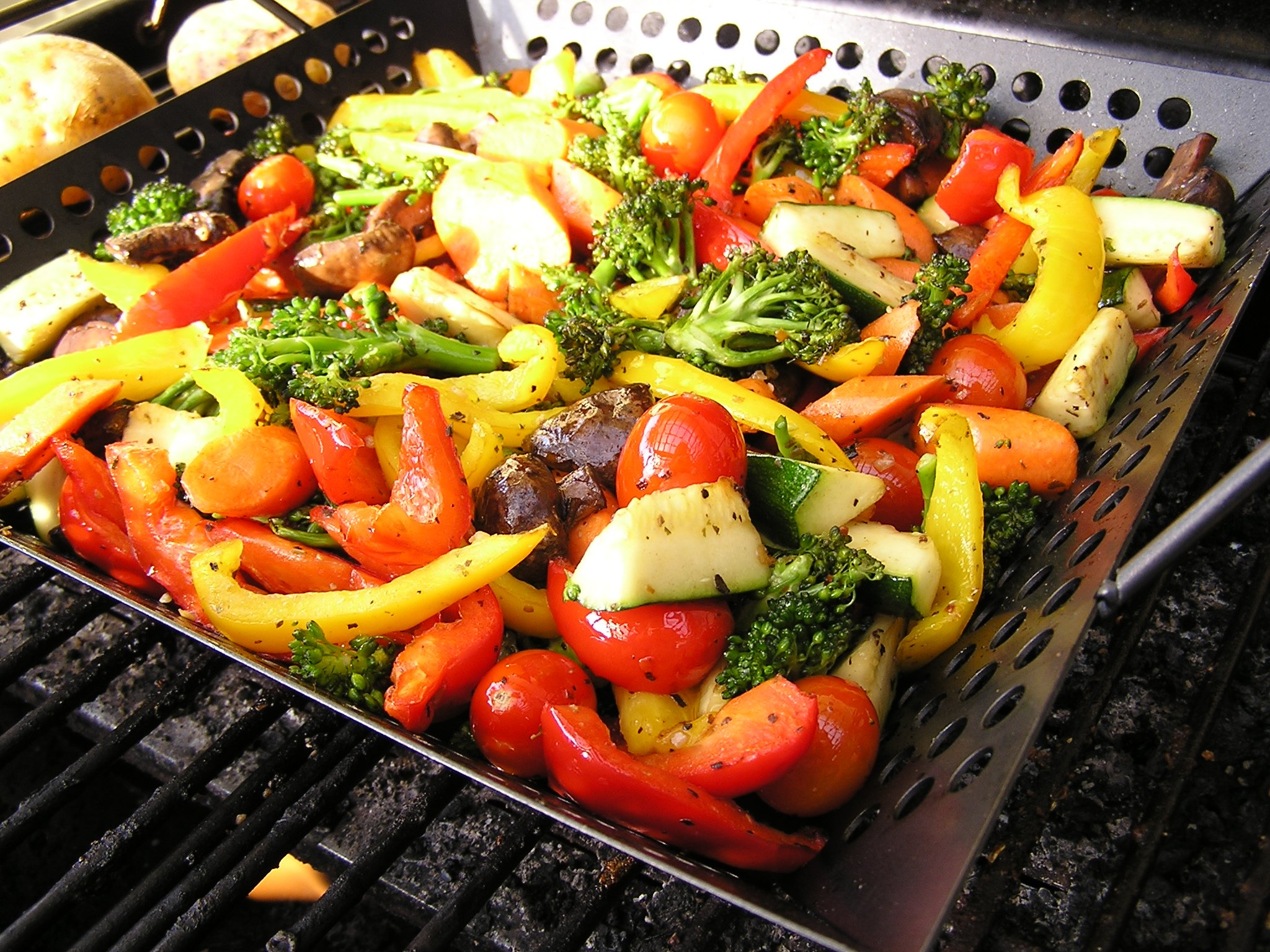 A medley of vegetables roasting on a barbeque