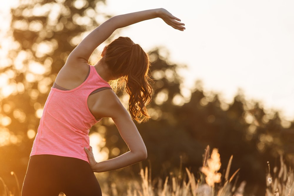woman stretching for morning workout