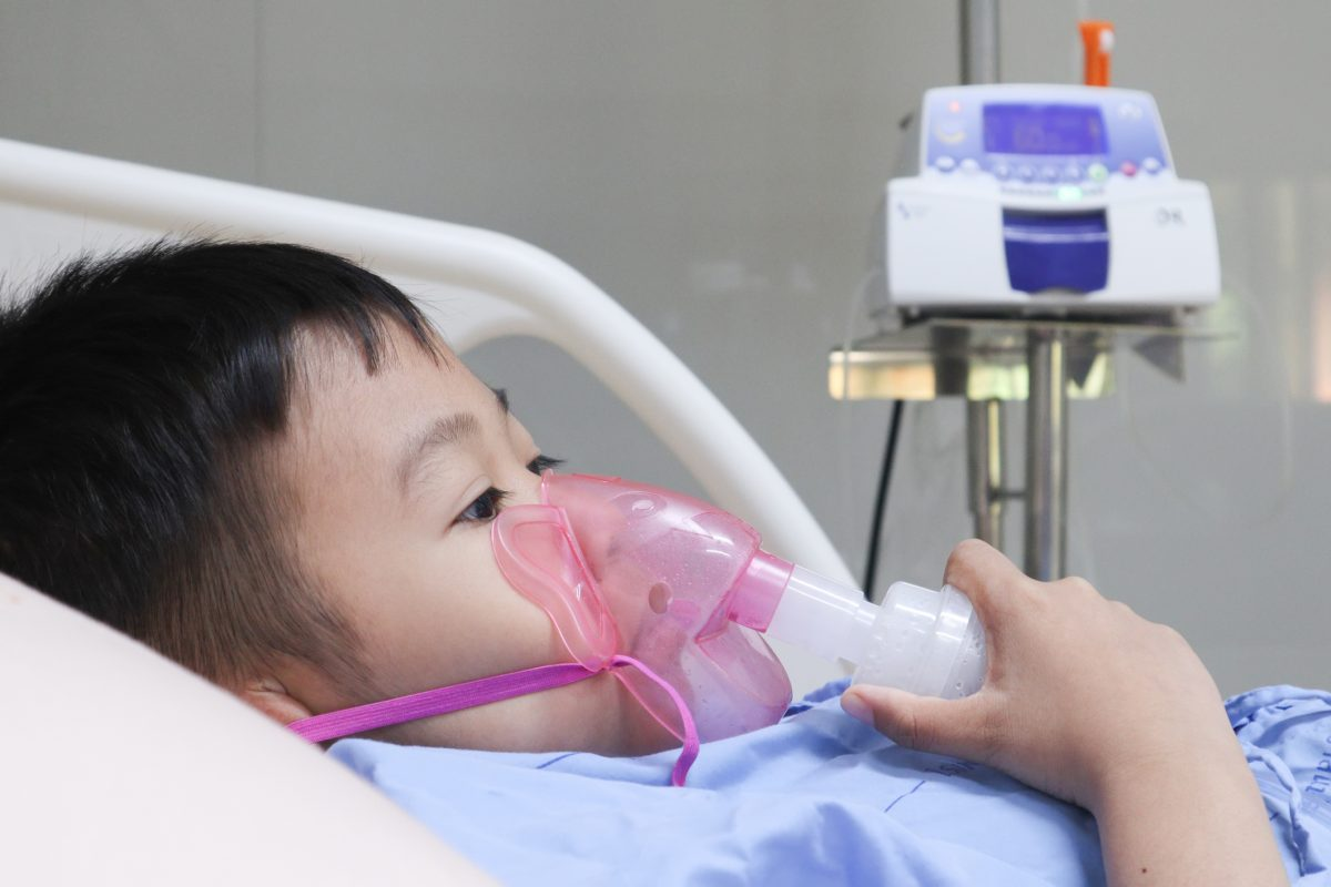 Child in hospital room.
