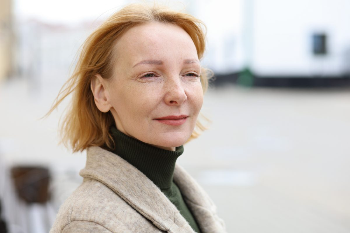 Mature woman with a traditional bob hairstyle.