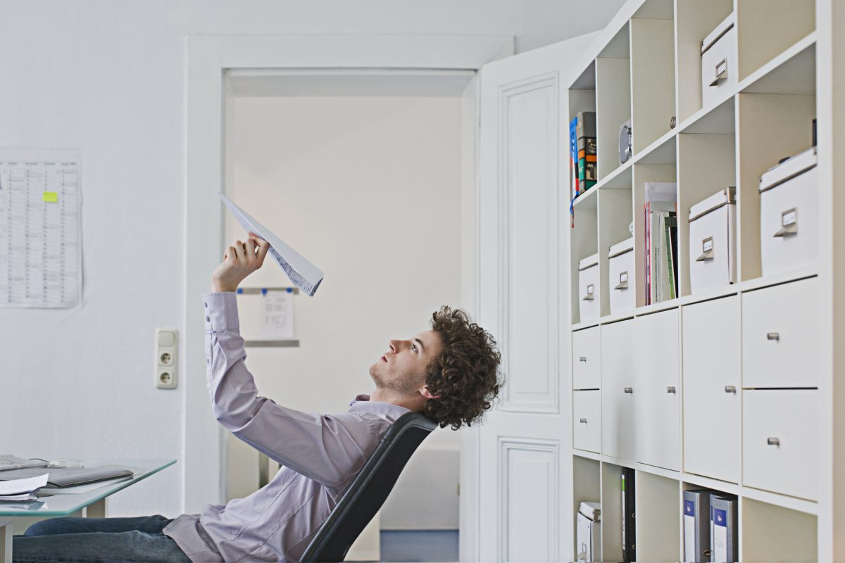 man procrastinating office