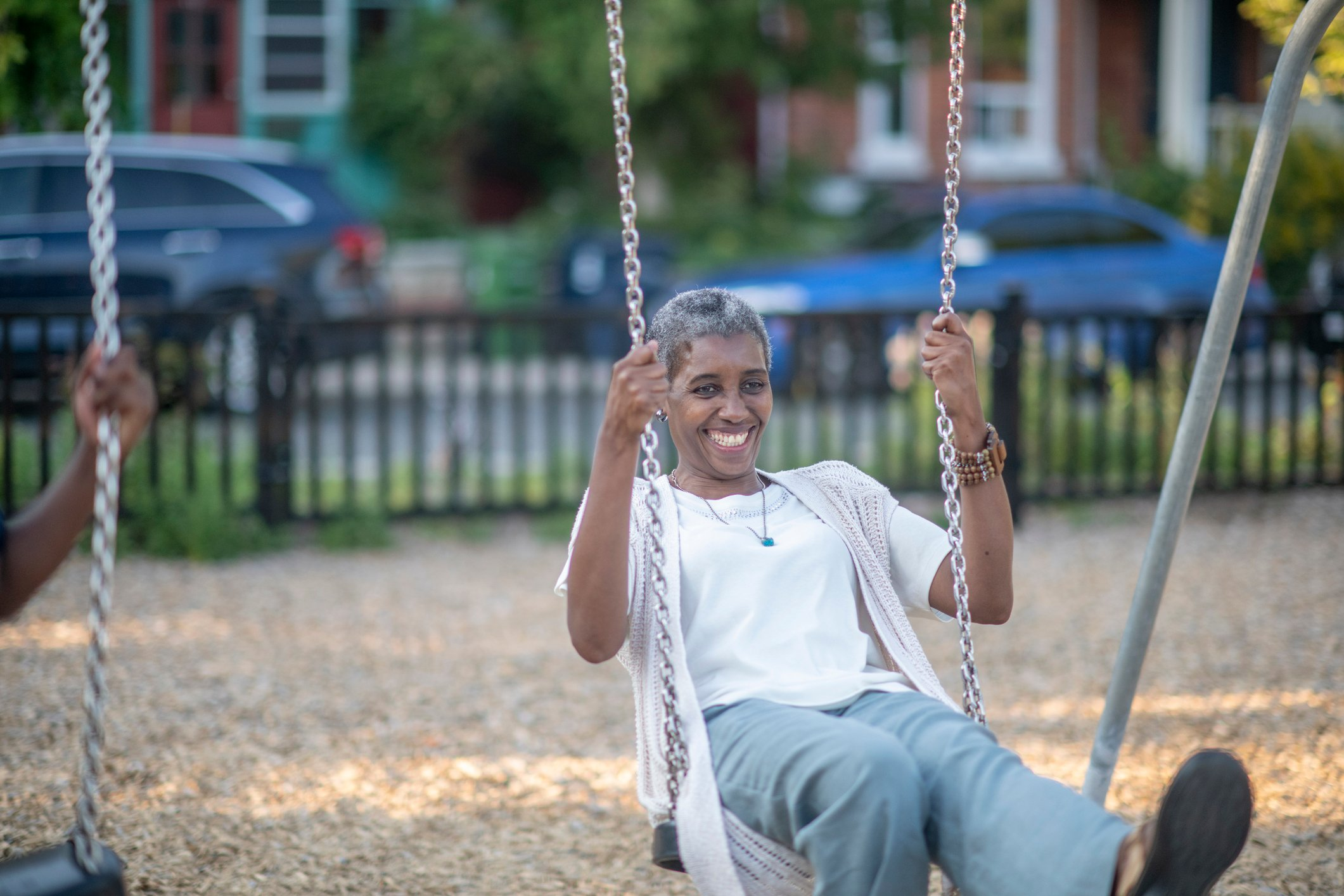 Senior African American woman on a swing.
