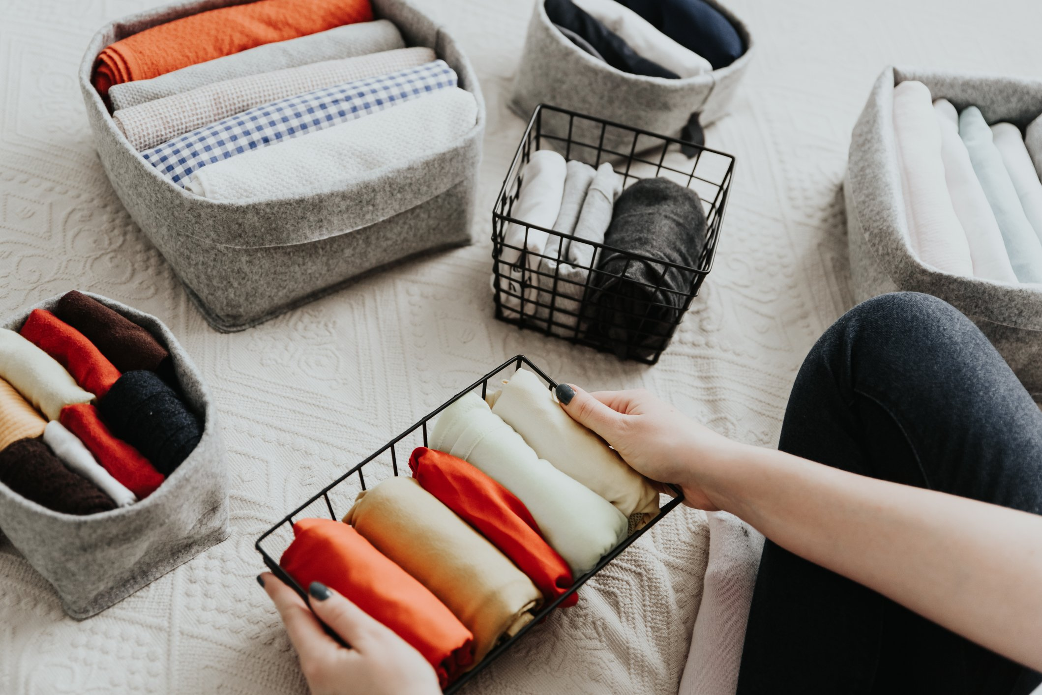 Wardrobe storage system. Clean up clothes with konmari method (Marie Kondo). Clothes neatly folded in bedroom