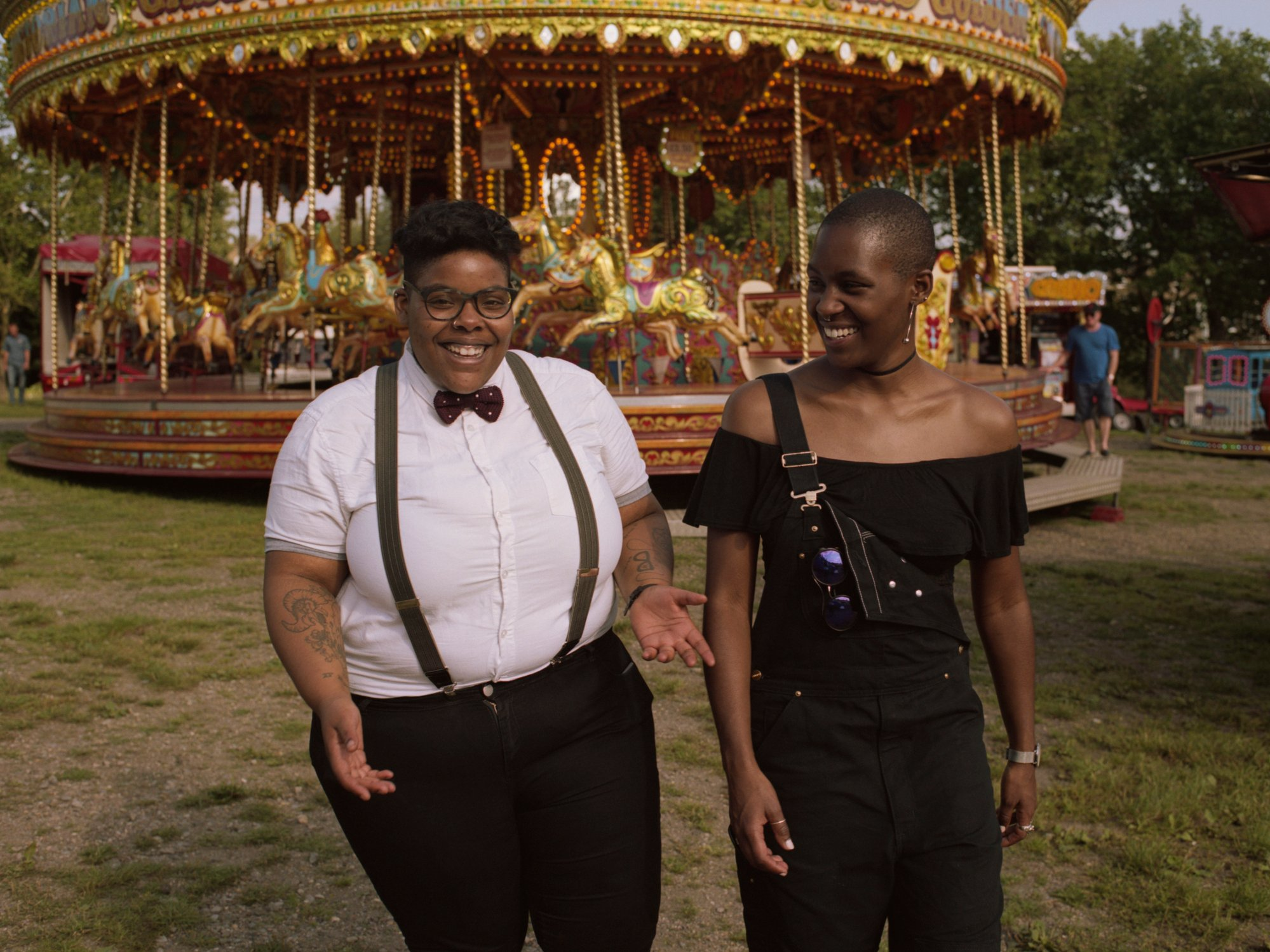 Two friends hanging out at a fairground