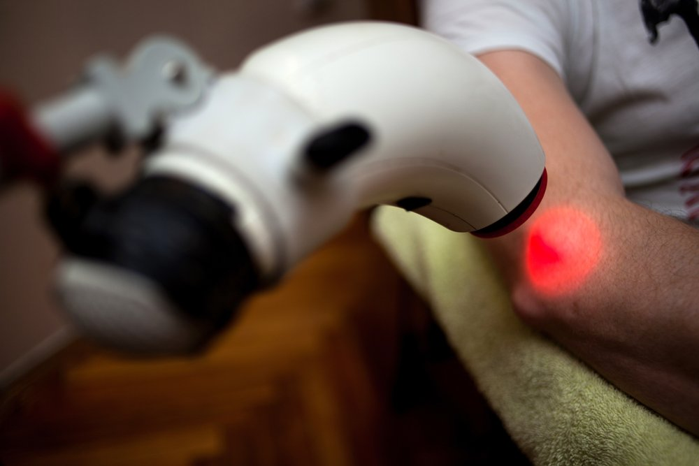 red light therapy targeted treatment of man's elbow