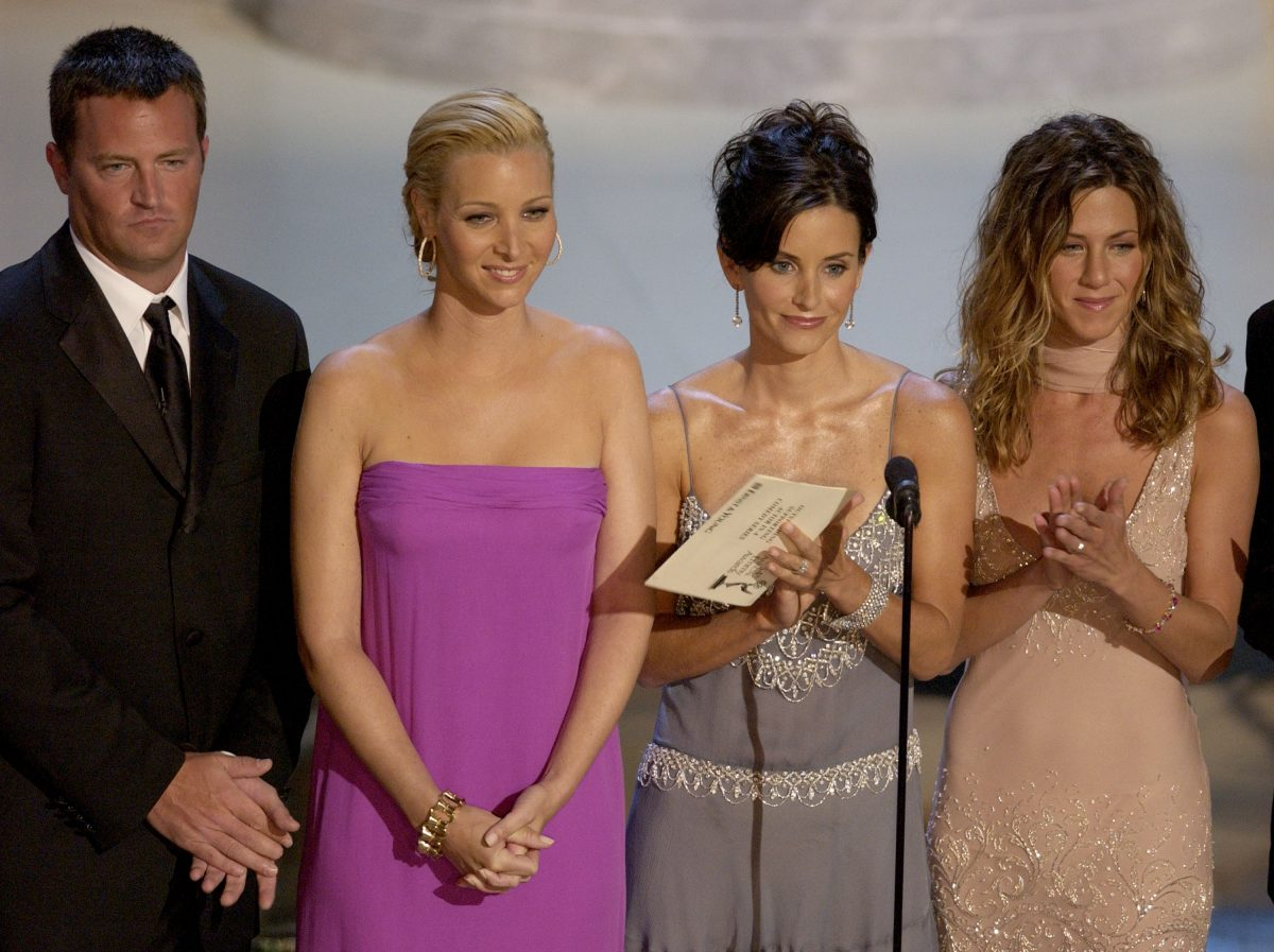 Actors Matthew Perry, Lisa Kudrow, Courteney Cox Arquette and Jennifer Aniston present an award during the 54th Annual Primetime Emmy Awards at the Shrine Auditorium on September 22, 2002 in Los Angeles, California