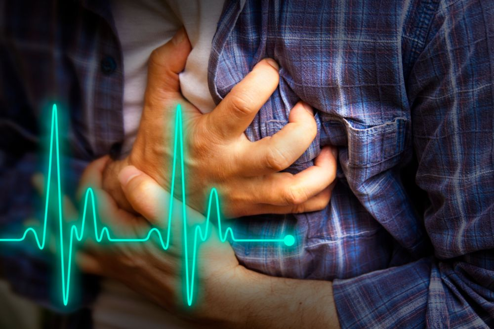 close up of man clutching his heart, heart beat overlay