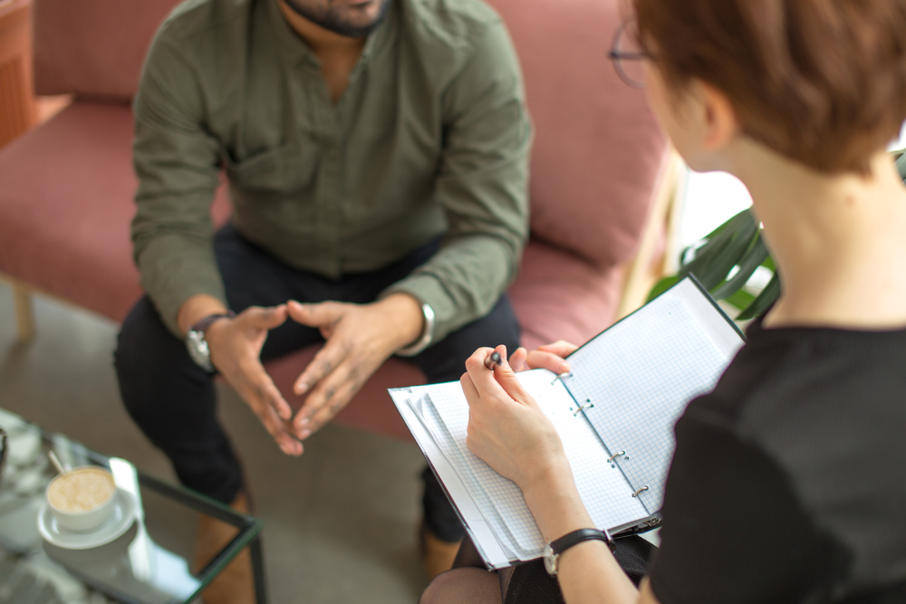 male patient speaking with psychologist