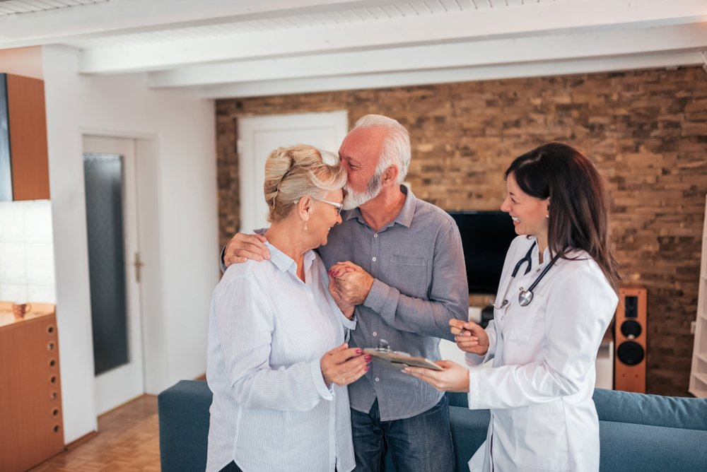 doctor giving good news to older couple